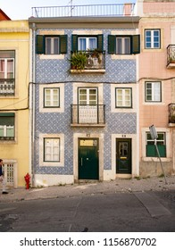 LISBON, PORTUGAL - 31 JULY 2018: The facade to a traditionally typical tiled town house on the steep hill streets of the Portuguese capital of Lisboa.