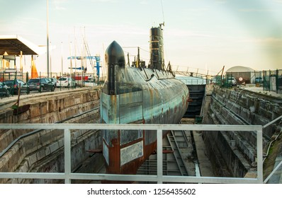 Lisbon, Portugal.  8 December 2018. Old  Portuguese Navy submarine being repared in dry docks, deactivated from service, will be a museum