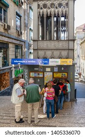 Lisbon, Portugal - April 14, 2018: Tourists in line buying tickets at ticket or box office. Elevador de Santa Justa Lift. 19th century. By Raul Mesnier de Ponsard, a Gustave Eiffel disciple.