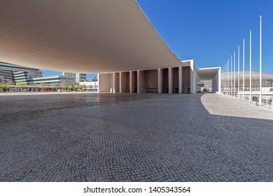 Lisbon, Portugal - April 2, 2018: Plaza under the canopy of Pavilhao de Portugal or Portuguese Pavilion. Parque das Nacoes or Park of Nations. By Alvaro Siza Vieira