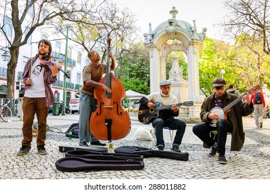 LISBON, PORTUGAL - APRIL 22, 2015: Four unidentified street musicians play Jazz and folk music at city square for the tourists and citizens.