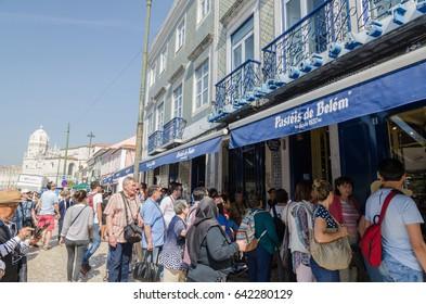 LISBON, PORTUGAL - APRIL 24: Tourists in line in front of the famous cafe Pasteis de Belem in Lisbon, Portugal on April 24, 2017