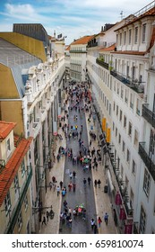 LISBON, PORTUGAL - APRIL 25 2017: View from the top of Santa Justa elevator of Rua do Carmo shopping street in Lisbon with people walking along the street.