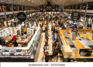 Lisbon, Portugal - APRIL 31, 2018: Food Market Mercado da Ribeira in Lisbon is a major tourist attraction, longer exposure to show some movement of the people.