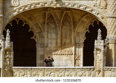 LISBON, PORTUGAL- APRIL 4, 2018: Unidentified man takes photos inside the majestic Jeronimos monastery cloister in Lisbon, Portugal