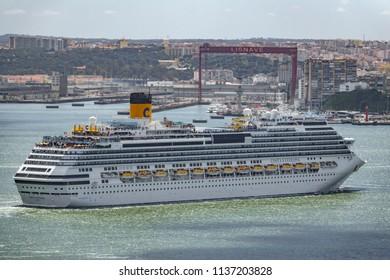 LISBON, PORTUGAL - APRIL 9, 2018: Costa Favolosa cruise navigating Tagus river in Lisbon, Costa Favolosa is a huge transatlantic for tourists