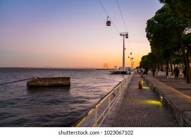LISBON, PORTUGAL - AUG 21: Telecabine Lisboa at Parque das Nacoes (Park of Nations) in Lisbon, Portugal, during epic sunset. The cable cars overlook the Vasco da Gama bridge on the Tagus river.