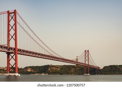 LISBON, PORTUGAL – AUGUST 03, 2018: The 25 de Abril Bridge, suspension bridge built in 1966, (train deck added in 1999. With a length of 2277 m, it is the 32nd largest suspension bridge in the world.