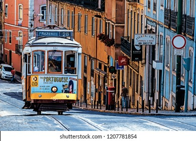 LISBON, PORTUGAL – AUGUST 03, 2018: The number 28 Lisbon tram, considered one of the main attractions of the city, passes through the popular tourist districts of Graca, Alfama, Baixa and Estrela.