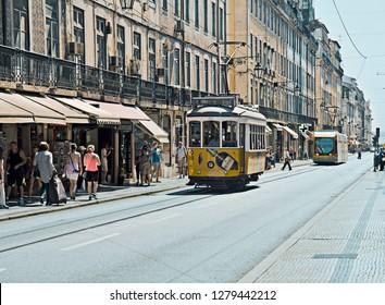 LISBON, PORTUGAL - AUGUST 08, 2017:  Vintage Lisbon tram goes of city street