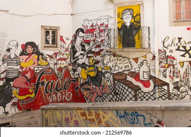 LISBON, PORTUGAL - AUGUST 09: street art on a wall on August 09, 2014 in Lisbon. The street is located in the popular artists quarter Alfama, that survived after the earthquake 1755
