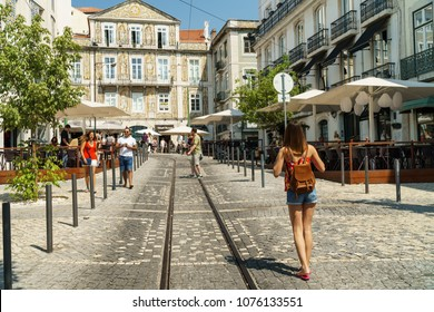 LISBON, PORTUGAL - AUGUST 13, 2017: Tourists Walking Downtown Lisbon City In Portugal