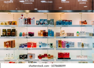 LISBON, PORTUGAL - AUGUST 15, 2017: Perfume Bottles And Cosmetic Products For Sale In Fashion Beauty Department Store Display