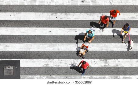 Lisbon, Portugal - August 16, 2015: People cross the street on a pedestrian crossing, in Lisbon, Portugal.