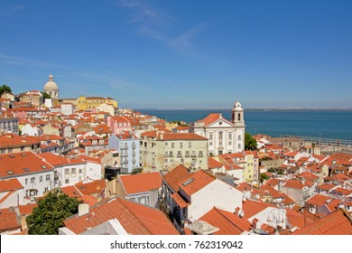LISBON, PORTUGAL, AUGUST 18, 2017, Red rooftops of the Pantheon, church and man buildings in the center of Lisbon, capital of Portugal, on a sunny day with clear blue sky. Lisbon, 18 August 2017
