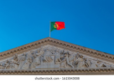 Lisbon, Portugal - August 2019 : Portuguese flag waving on top of the Sao Bento Palace, the seat of the Assembly of the Portuguese Republic, the parliament of Portugal in Lisbon