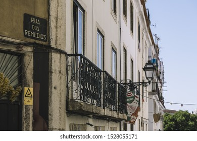 Lisbon, Portugal – august, 2019: Rua dos Remedios is a typical portuguese cobblestone street in Lisbon with venues to listen Fado