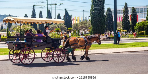 Lisbon, Portugal - August 2019 : Tourists in a horse carriage in front of the Jeronimos Monastery or Hieronymites Monastery in Belem, Lisbon