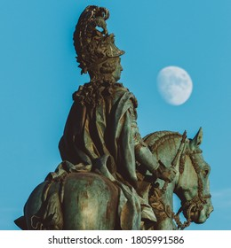 Lisbon, Portugal - August 2020: Equestrian statue of King John I in the Praca do Comercio in Lisbon, Portugal with a full moon