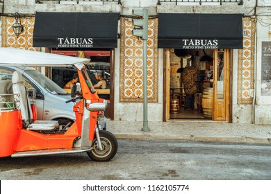 LISBON, PORTUGAL - AUGUST 21, 2017: Tourists In Tuk Tuk Vehicles Visiting Major Attractions Downtown Lisboa City