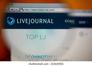 LISBON, PORTUGAL - AUGUST 27, 2014: Photo of LiveJournal homepage on a monitor screen through a magnifying glass.