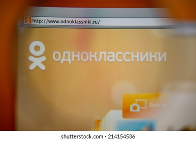 LISBON, PORTUGAL - AUGUST 27, 2014: Photo of Odnoklassniki homepage on a monitor screen through a magnifying glass.