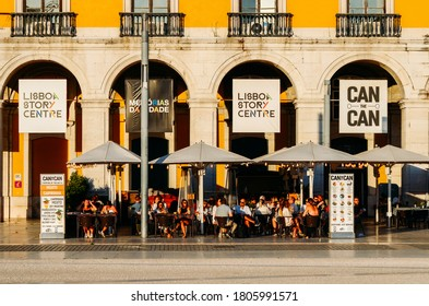 Lisbon, Portugal - August 29, 2020: Customers relaxing at a pavement cafe in the Praca do Comercio, Baixa, Lisbon, Portugal