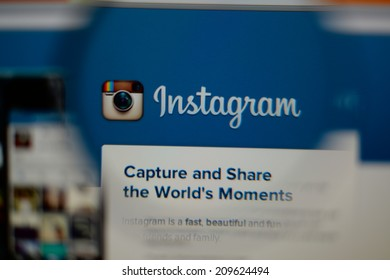 LISBON, PORTUGAL - AUGUST 3, 2014: Photo of Instagram homepage on a monitor screen through a magnifying glass.