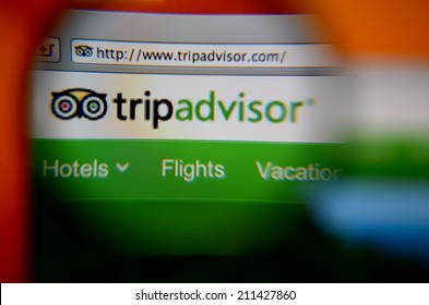 LISBON, PORTUGAL - AUGUST 3, 2014: Photo of TripAdvisor homepage through a magnifying glass.