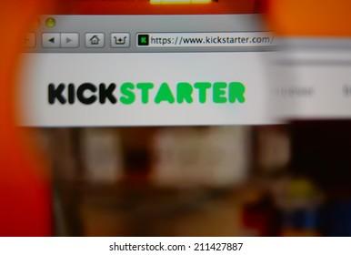 LISBON, PORTUGAL - AUGUST 3, 2014: Photo of Kickstarter homepage through a magnifying glass. Kickstarter is a crowdfunding platform.