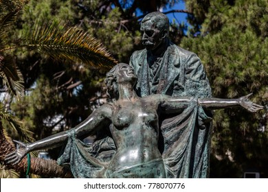 "Lisbon, Portugal, August 6, 2017: Statue of Eca de Queiroz, a Portuguese realism writer. Sculpted by Teixeira Lopes in 1903. The writer holding a nude woman that symbolically represents the ""truth""."