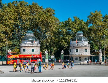 Lisbon, Portugal - August 8th, 2018: Entrance to the Lisbon Zoo is prepared for current summer season with red elements of decor on the towers, which are looks like a gift to attract a visitors
