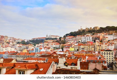 Lisbon Portugal - Beautiful panoramic view of the red roofs of houses in antique historical district Alfama and the Tagus River and bridge from Sao Jorge Castle