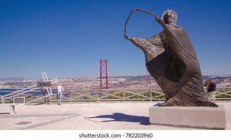 LISBON, PORTUGAL - CIRCA APRIL 2016: The 25 de Abril Bridge is a bridge connecting the city of Lisbon to the municipality of Almada on the left bank of the Tejo river trom viewpoint with statue
