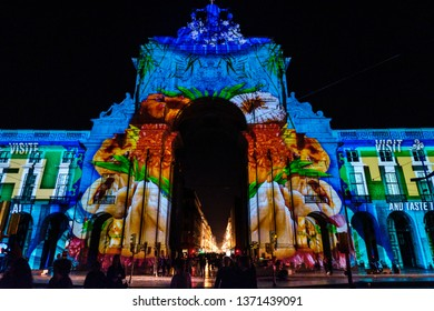 LISBON, PORTUGAL - CIRCA MARCH 2019: The famous Arco da Augusta (Augusta's Arch) in Praça do Comercio, during a video projection celebrating the relationship between Portugal and Macau.