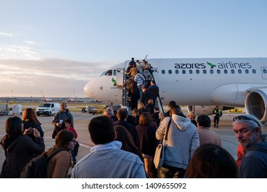 LISBON, PORTUGAL - CIRCA MARCH 2019: People boarding an airplane from the Azores Airlines, a company from Azores Islands, previously known as SATA.