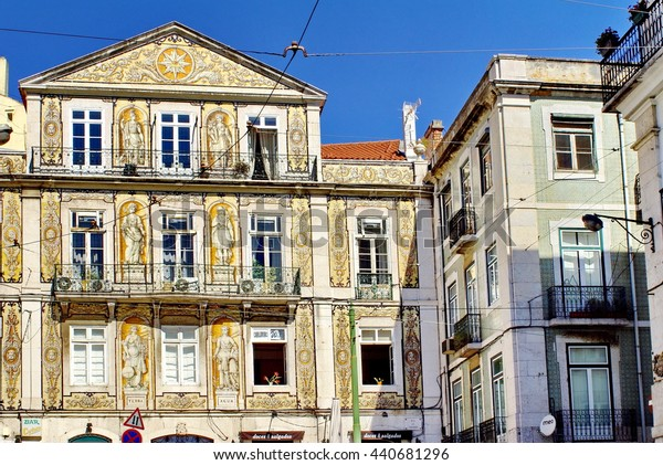 LISBON, PORTUGAL, CIRCA SEPTEMBER 2012: Apartments with tile facades, including one with a Greek motif