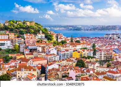 Lisbon, Portugal City Skyline with Sao Jorge Castle and the Tagus River.