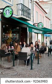 LISBON, PORTUGAL - DECEMBER 19: people having a break at Starbucks coffee esplanade on December 19, 2011 in Lisbon, Portugal. The largest coffeehouse company in the world with 18,887 stores