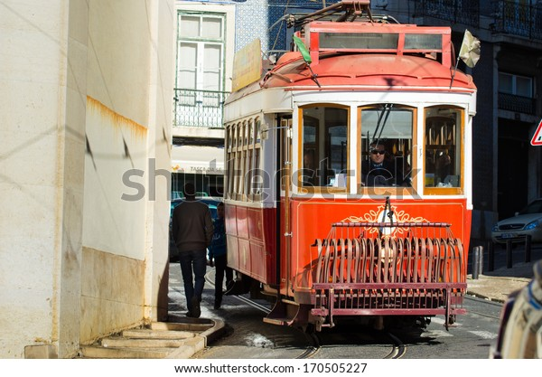 LISBON, PORTUGAL - DECEMBER 2, 2013: The number 11 tram traveling along a street in the city of Lisbon.