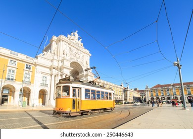 LISBON, PORTUGAL - DECEMBER 21- Yellow trams on a square Praca de Comercio in Lisbon, Portugal on December 21, 2014