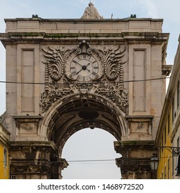 """Lisbon, Portugal - December 23 2012: The triumphal arch-like """"Arco da Rua Augusta"""" (Rua Augusta Arch), built in 1755 top commemorate the city's reconstruction after the big earthquake"""