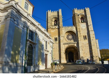 Lisbon / Portugal — December 3, 2019: view of Lisbon Cathedral, known as Se de Lisboa. Located in the Alfama district, this is the oldest church of the city that combines several architectural styles