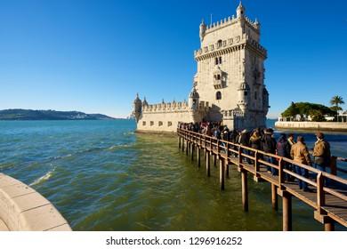 LISBON, PORTUGAL - DECEMBER 30, 2014: Tourists visiting Belem Tower.