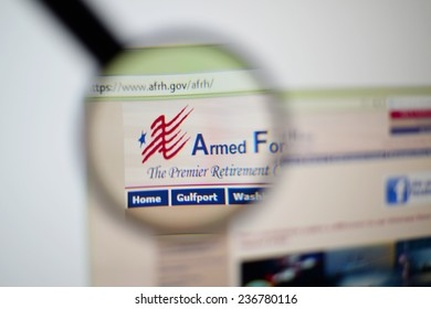 LISBON, PORTUGAL - December 9, 2014: Photo of the Armed Forces Retirement Home (AFRH) homepage on a monitor screen through a magnifying glass.