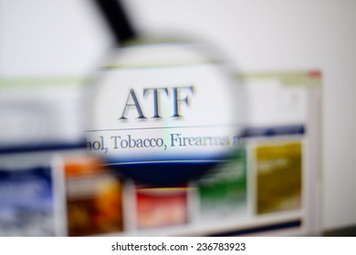 LISBON, PORTUGAL - December 9, 2014: Photo of the Bureau of Alcohol, Tobacco, Firearms and Explosives (ATF, BATF, and BATFE) homepage on a monitor screen through a magnifying glass.
