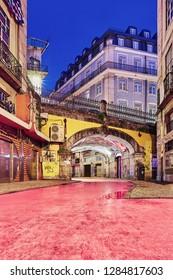 """Lisbon, Portugal - December 9, 2018: """"Pink Street"""" pedestrian street of Rua Nova do Carvalho in the Cais do Sodré area of Lisbon during blue hour"""
