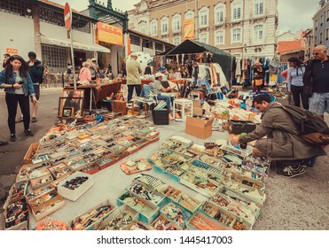LISBON, PORTUGAL: Decor elements, fashion stuff and vintage bargains for sale on outdoor flea market with young visitors on 18 May, 2019. Portuguese language has 250 million speakers around the world