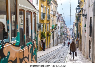 "Lisbon, Portugal, Europe - View from ""Bairro Alto"" tramway street on a cloudy day with shadows of people passing (long Expo)"