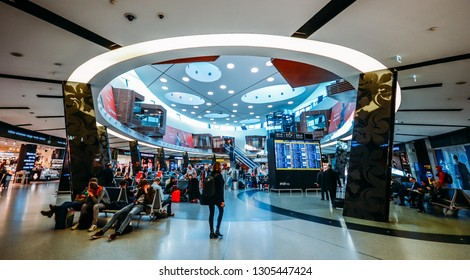 Lisbon, Portugal - Feb 5, 2019: Busy main seating area at departure's terminal at Humberto Delgado Airport International Airport in Lisbon, Portugal's largest airport